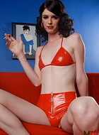 Hot smoking photos Seductive Mandy posing in red latex costume.