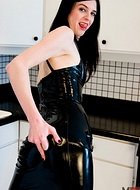 Black latex dress. Naughty Mandy Mitchell in lascivious black latex dress
