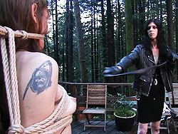 Mandy whips kimberly kills. TS domme whipping a shemale in the forest
